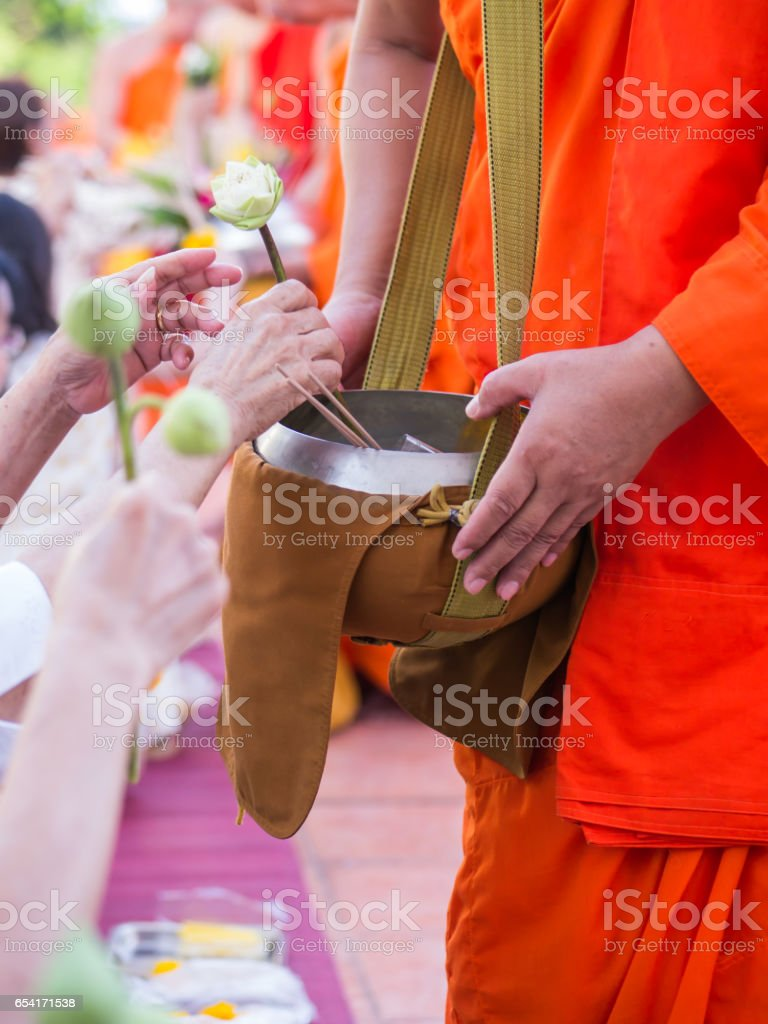Offer sacrifice flowers to monk stock photo
