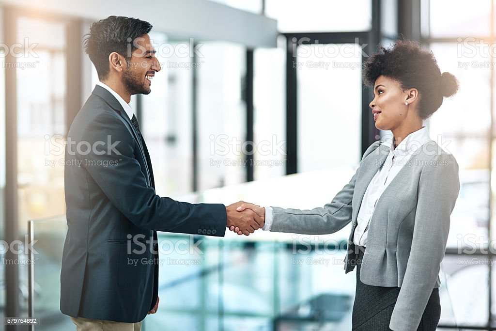Offering a handshake with sincerity, confidence and authority stock photo