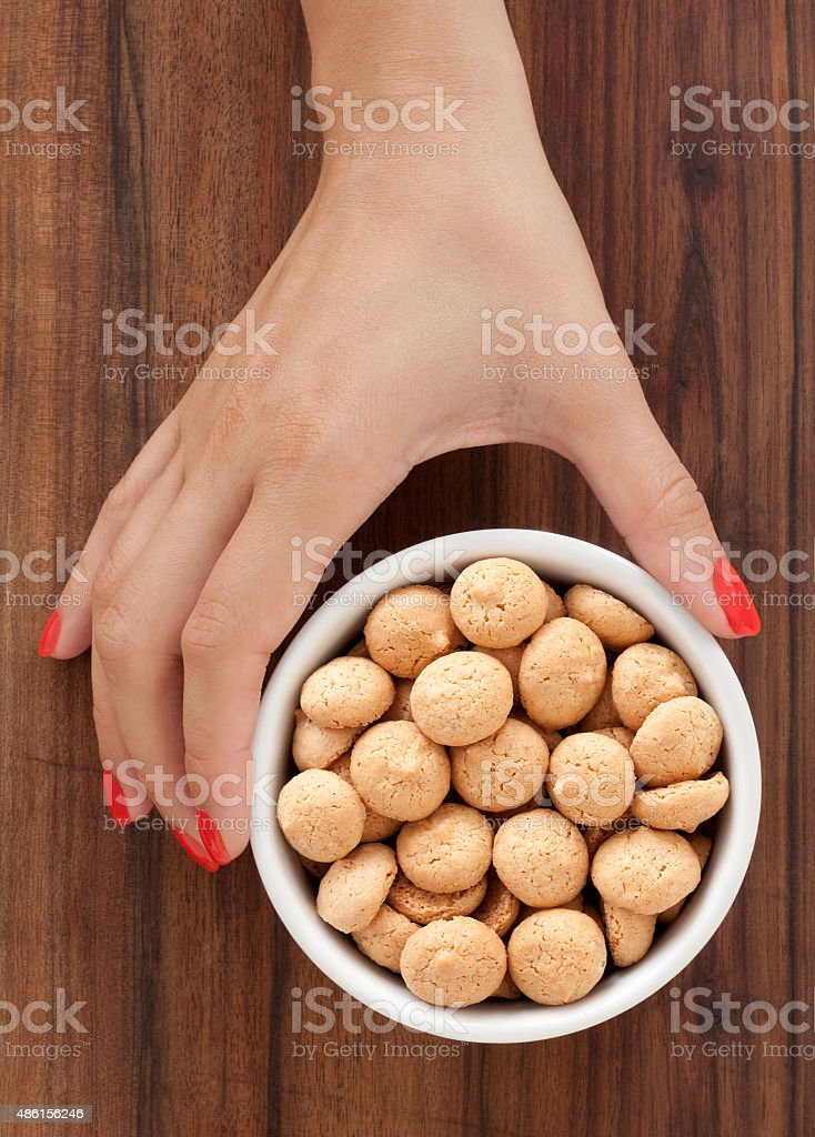 Offering amaretto biscuits stock photo