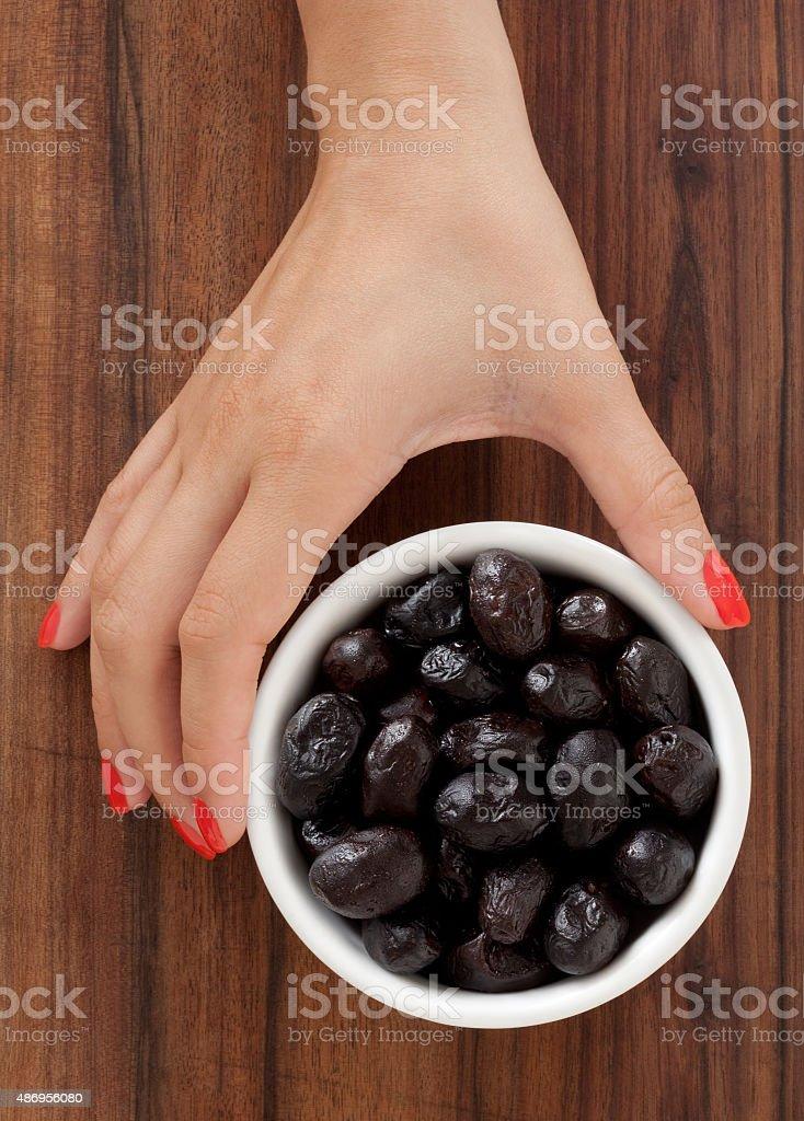 Offering black olives stock photo