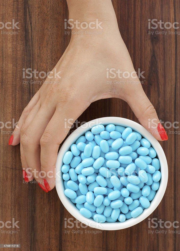 Offering blue pills stock photo