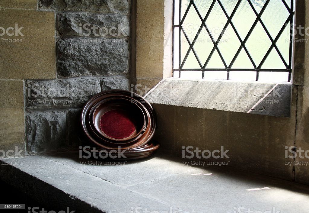 Offering bowl for collecting money in church stock photo
