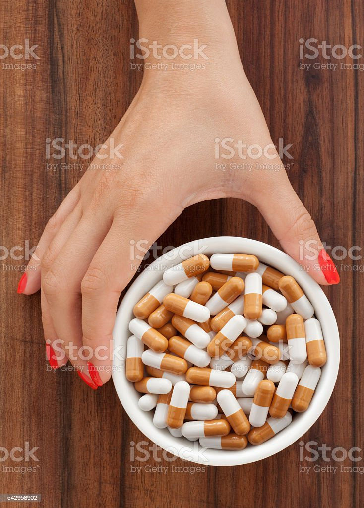 Offering brown capsules stock photo