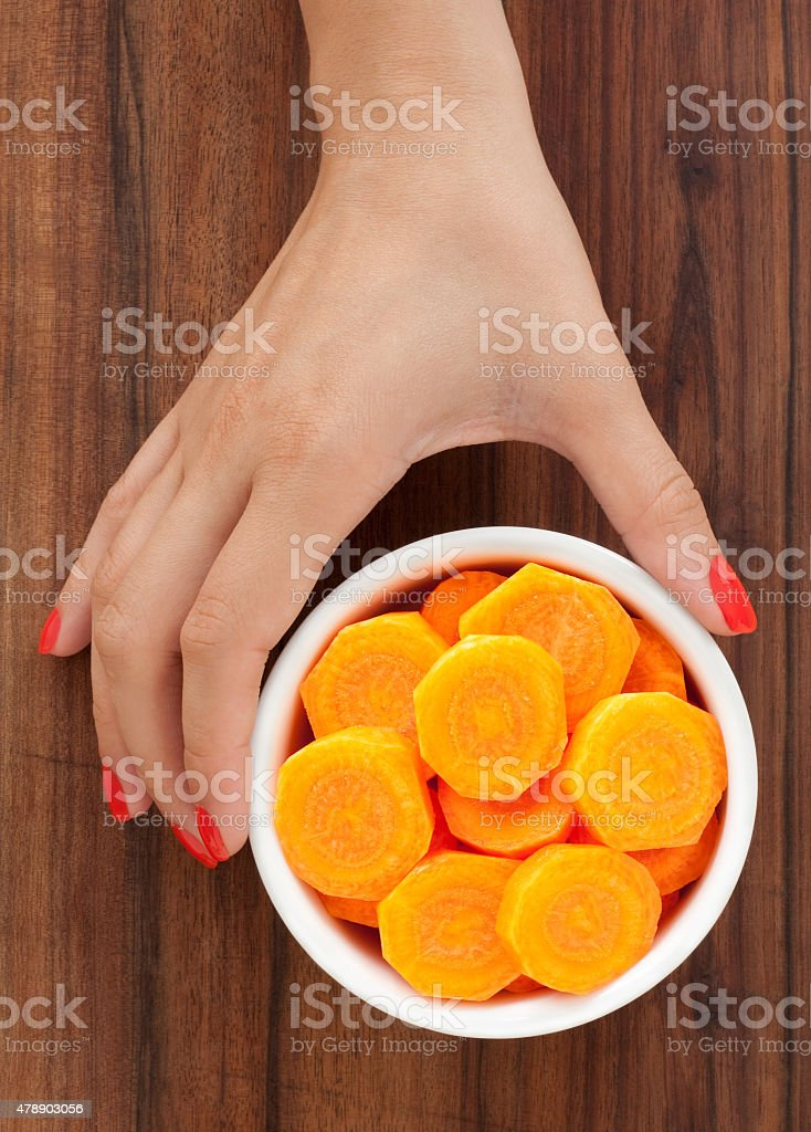 Offering carrot slices stock photo