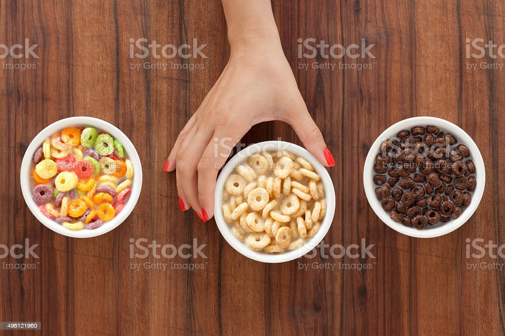 Offering cereal rings with milk stock photo