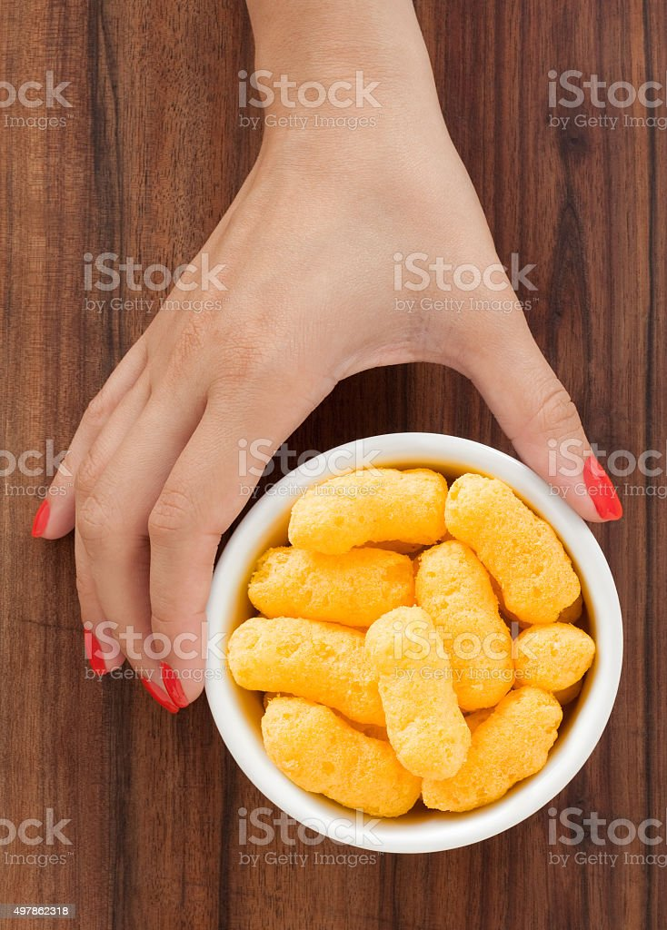 Offering cheese puffs stock photo