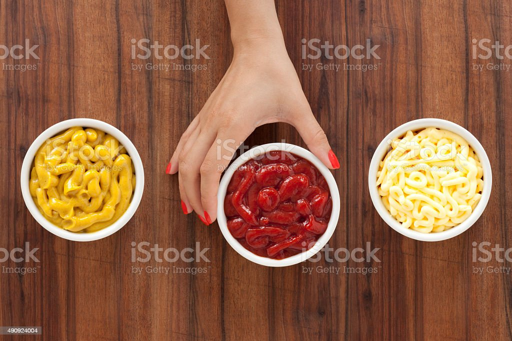 Offering condiments stock photo