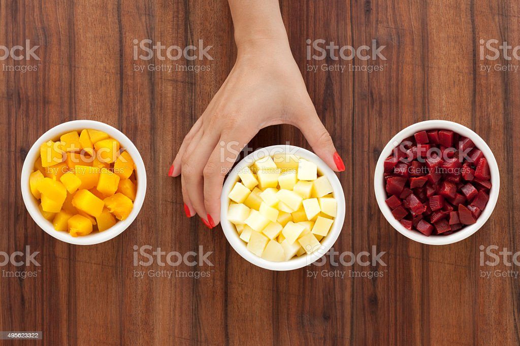 Offering diced and boiled root vegetables stock photo