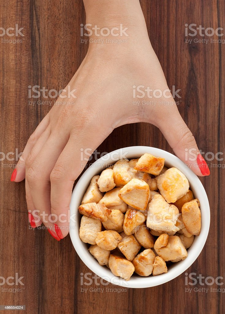 Offering diced chicken meat stock photo