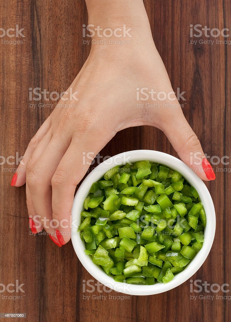 Offering diced green bell pepper stock photo