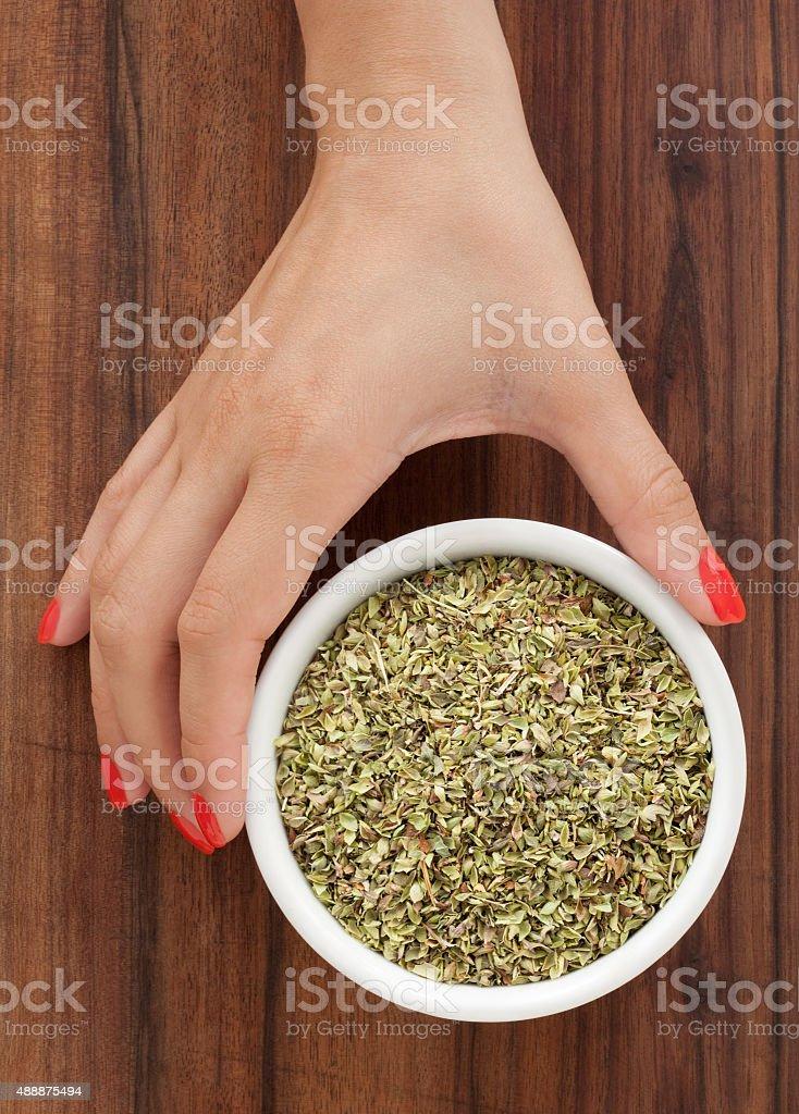 Offering dried oregano stock photo