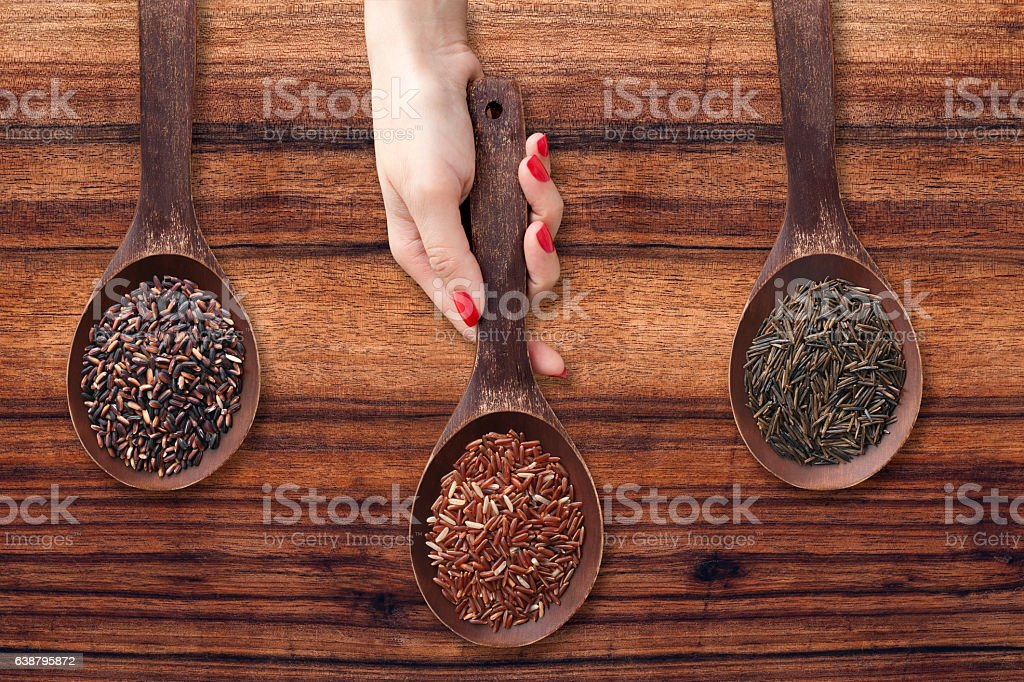 Offering exotic rices stock photo