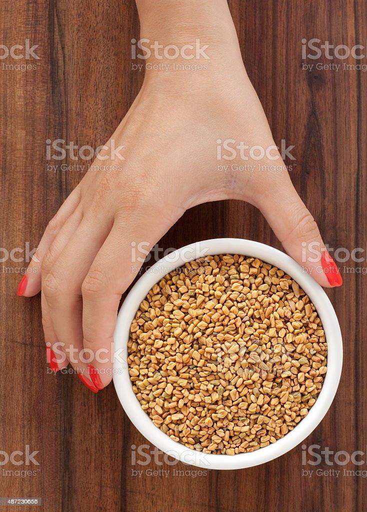 Offering fenugreek stock photo