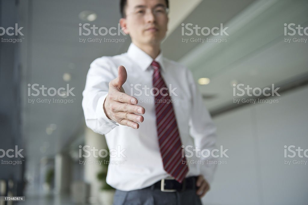 offering for handshake royalty-free stock photo
