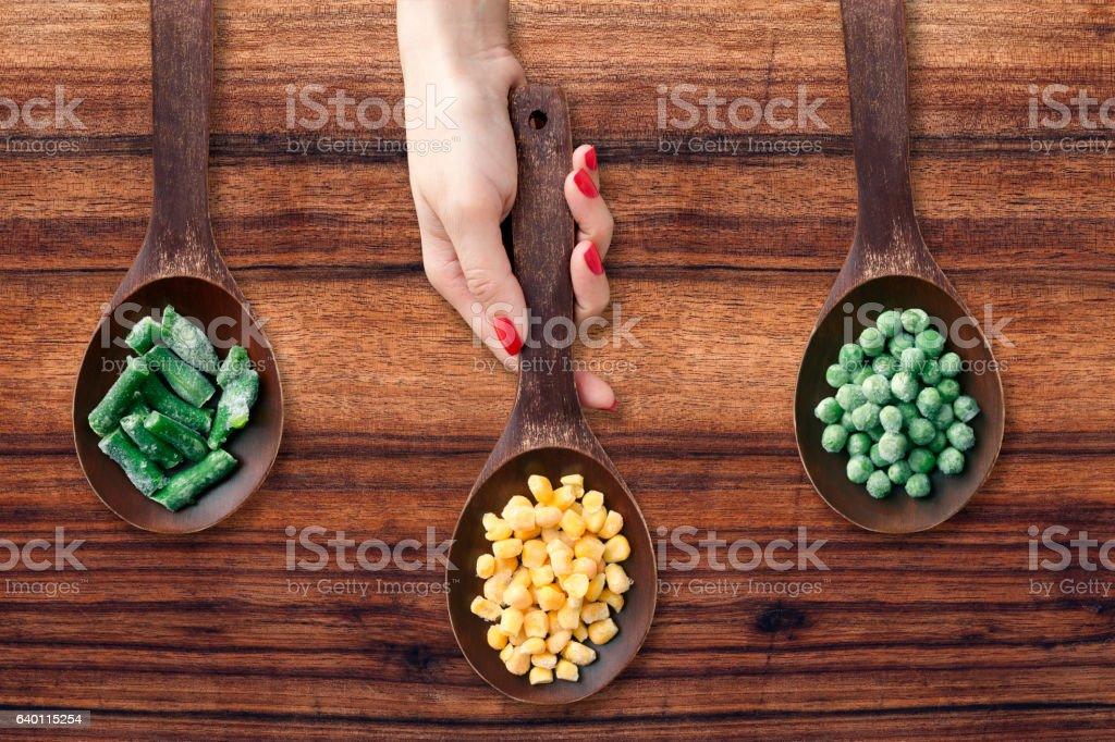 Offering frozen vegetables stock photo