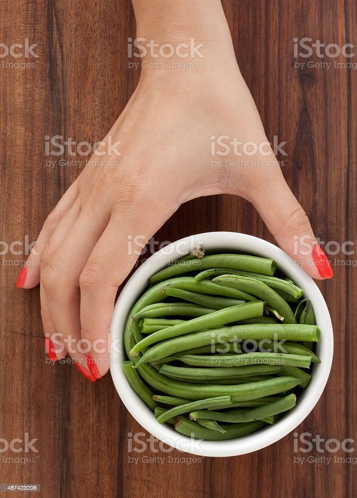 Offering green beans stock photo
