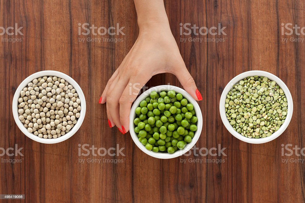 Offering green peas stock photo