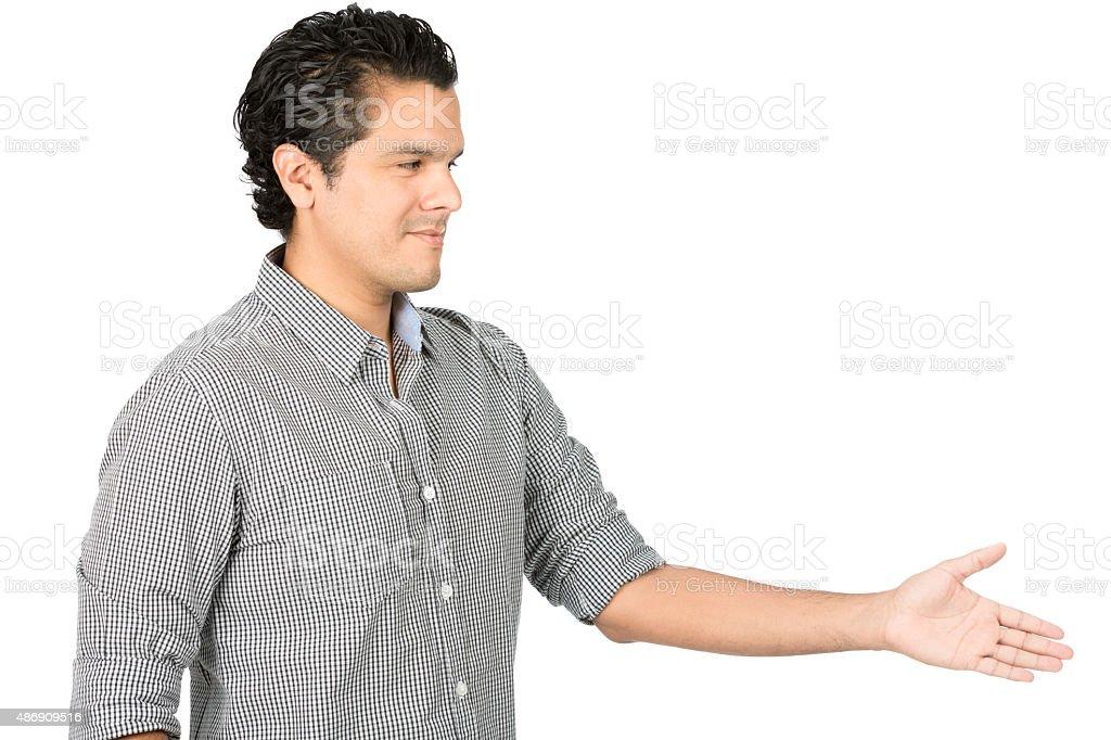 Offering Handshake Smiling Hispanic Man Away Side stock photo