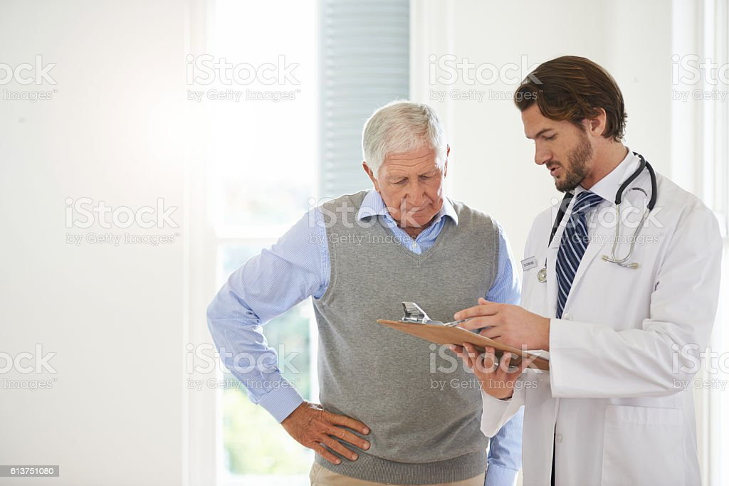 Offering his expert advice to his patient stock photo
