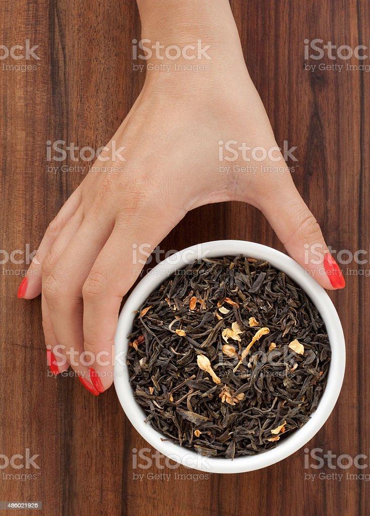 Offering jasmine tea stock photo