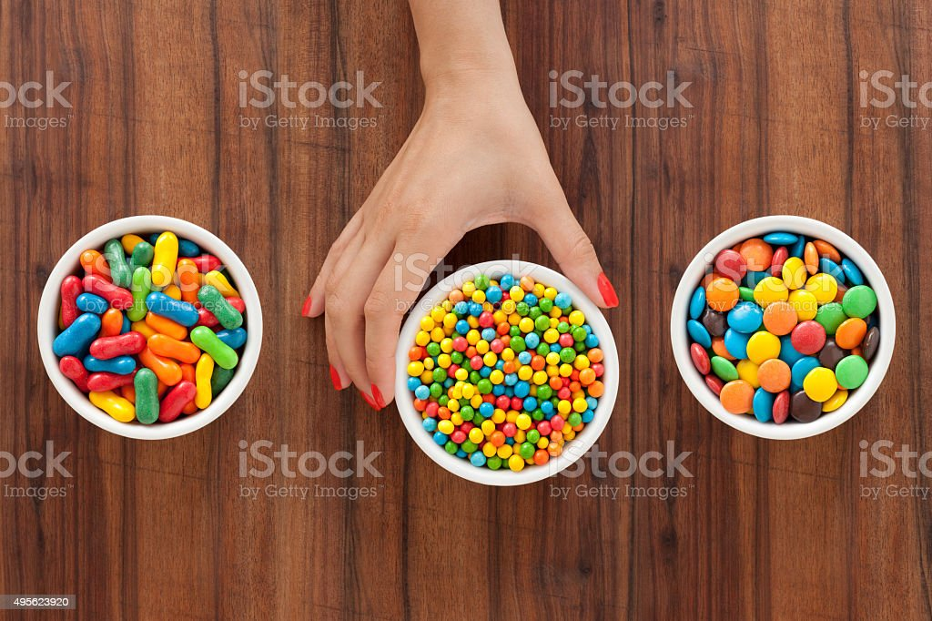 Offering multicolored candy stock photo