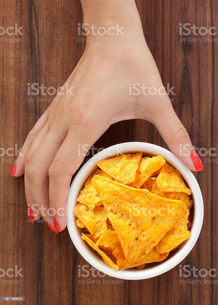 Offering nachos stock photo