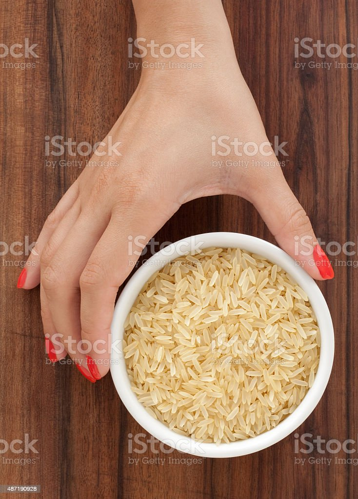 Offering parboiled rice stock photo