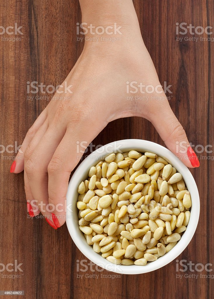 Offering pine nuts stock photo
