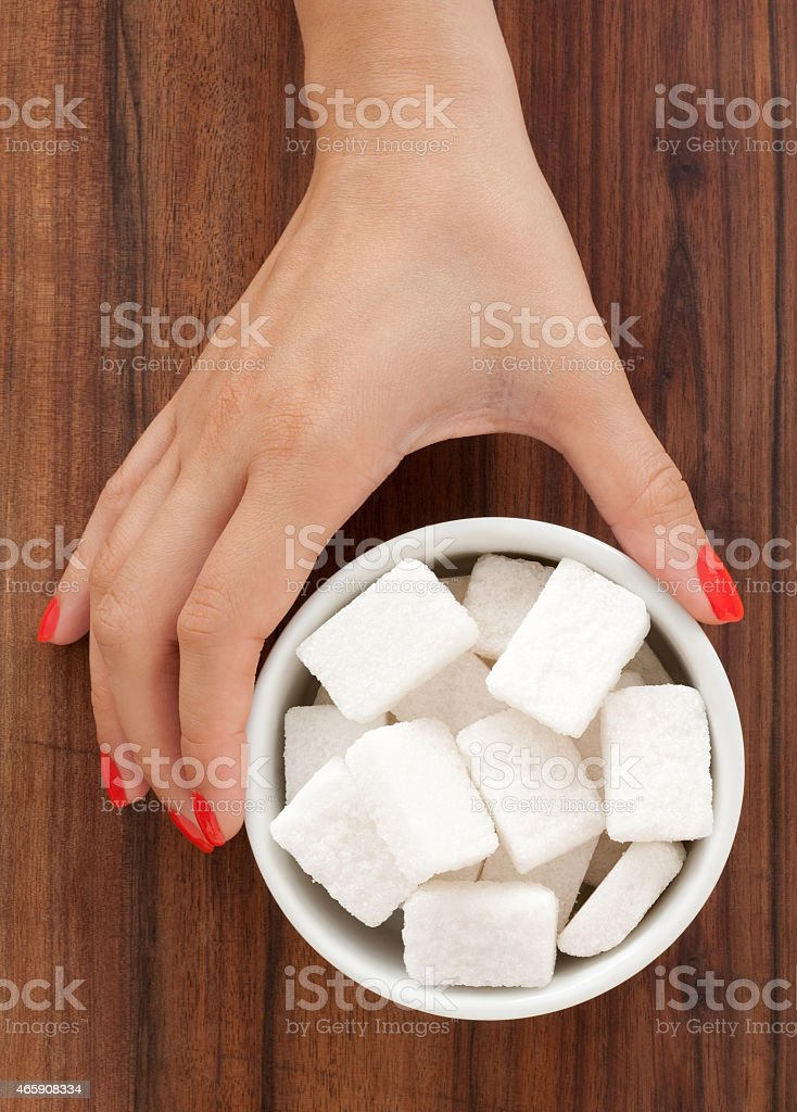 Offering sugar cubes stock photo