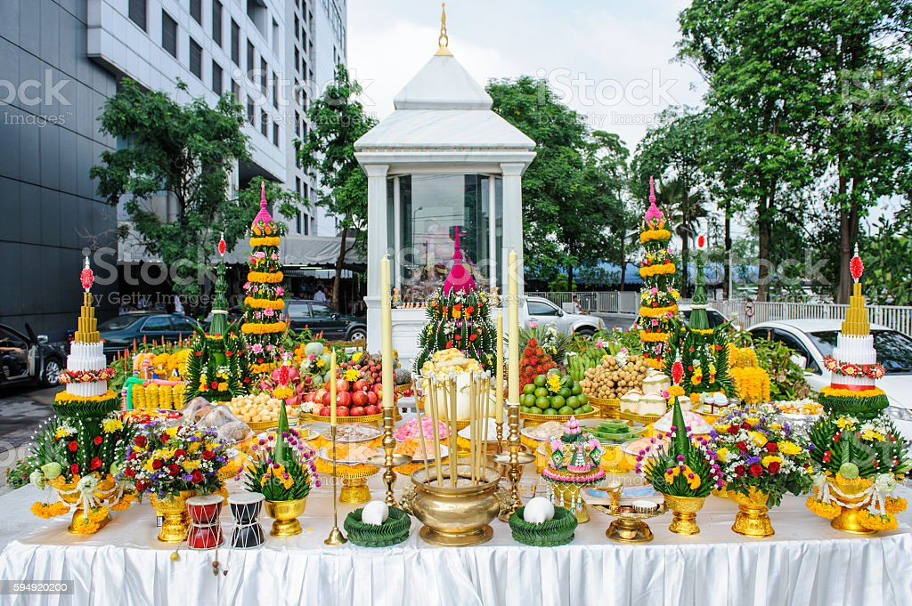 Offering Thai food pay respect to god stock photo