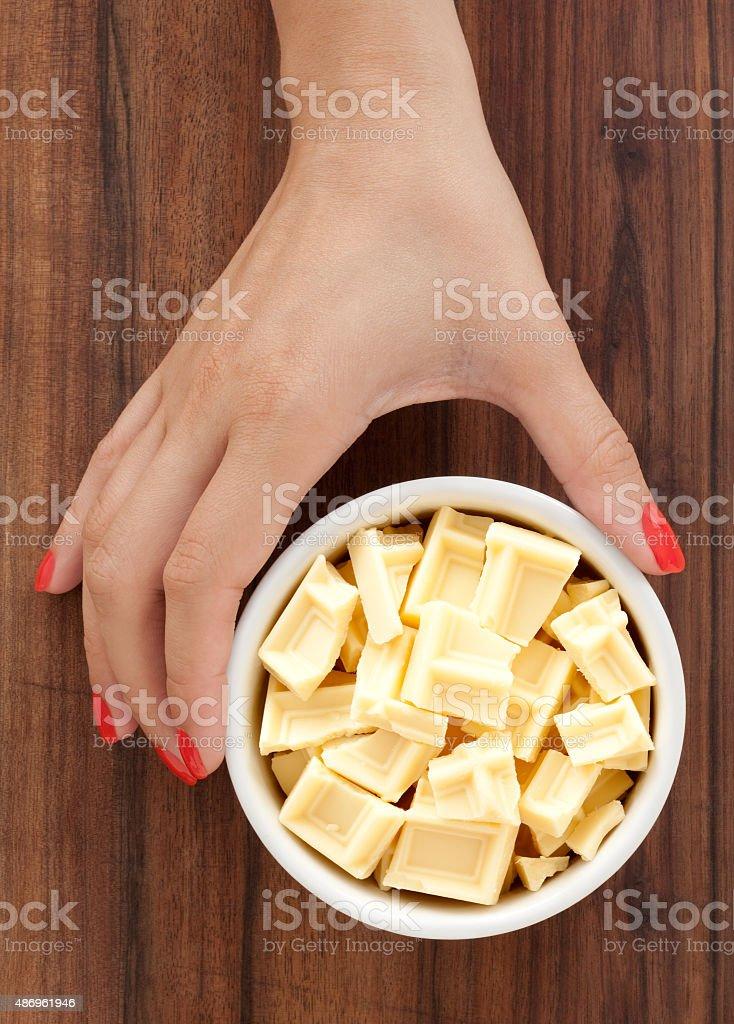 Offering white chocolate blocks stock photo