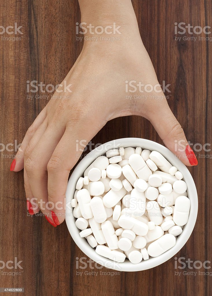 Offering white pills royalty-free stock photo