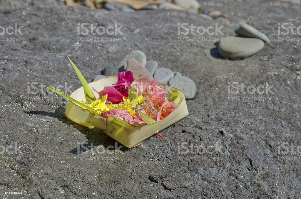 Offerings for the divine on a rock - Bali Indonesia royalty-free stock photo