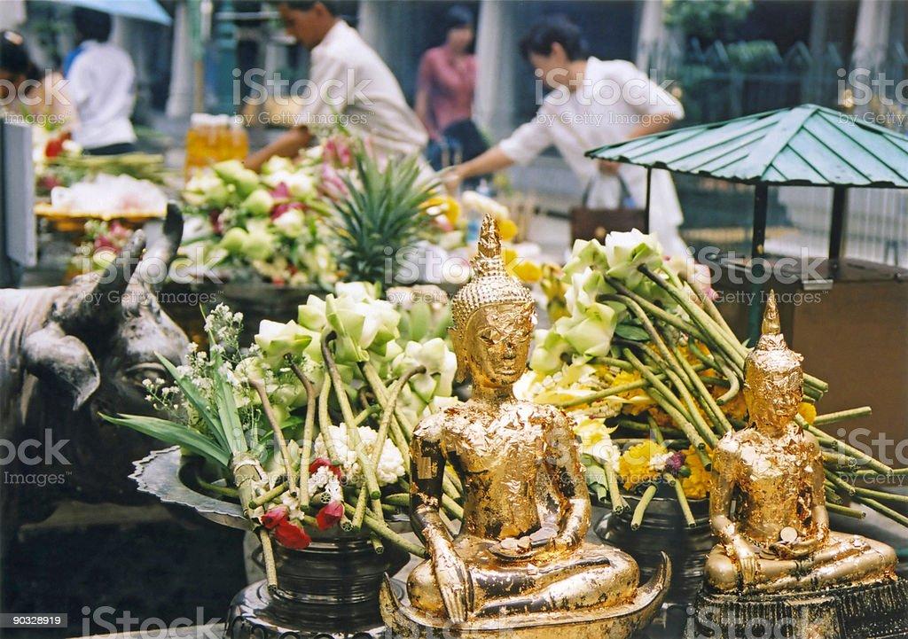 Offerings in bangkoks grand palace royalty-free stock photo