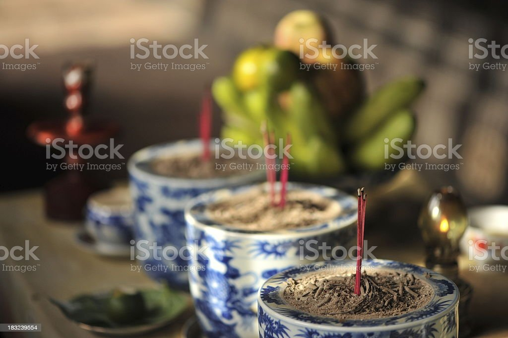 Offerings to ancestors on buddhist altar stock photo