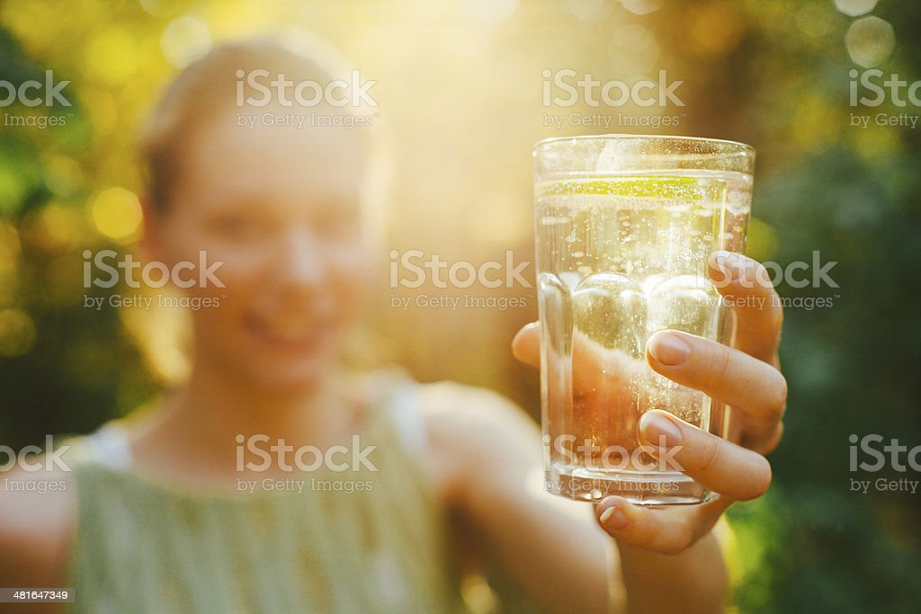 Offerring glas of water stock photo