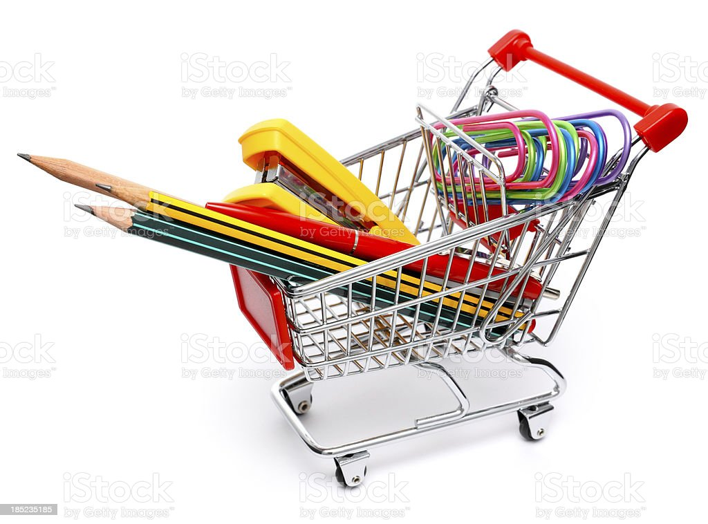 office accessories in shoppin cart royalty-free stock photo