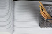 Office accessories on a copybook sheets.