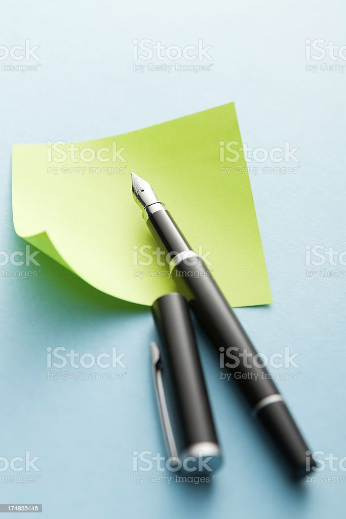 Office: Adhesive Note and Pen royalty-free stock photo