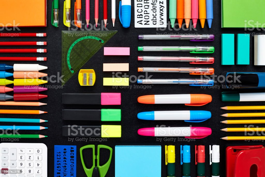 Office and school supplies are arranged on blackboard stock photo