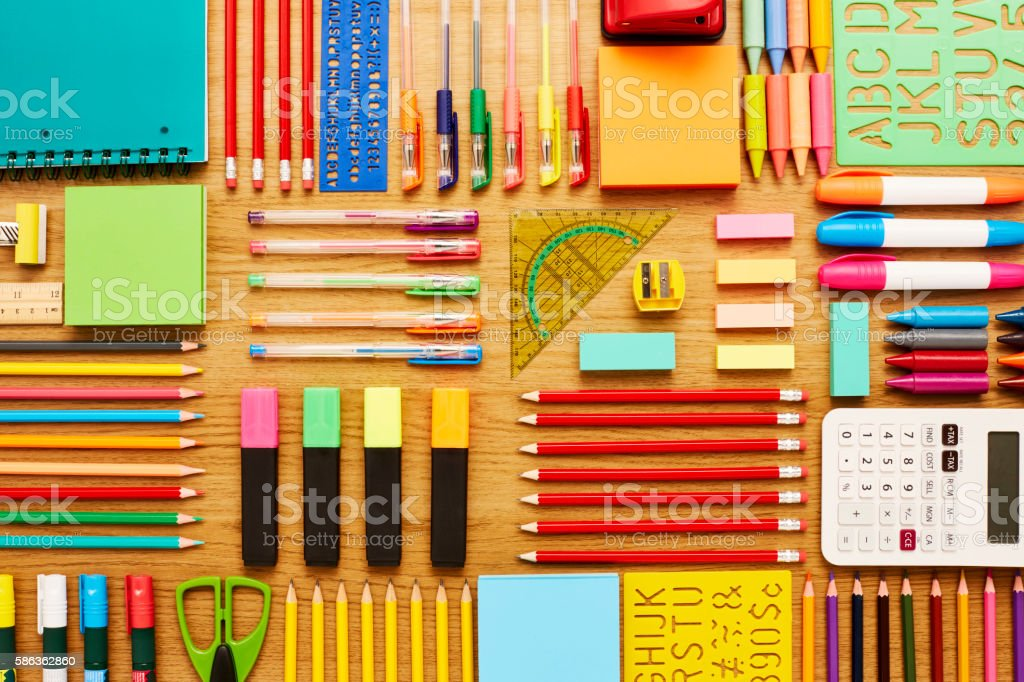 Office and school supplies arranged on wooden table - Knolling stock photo