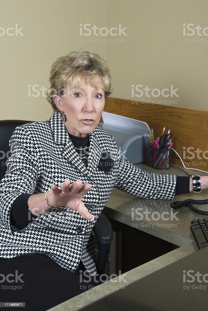 Office assistant asking you to wait at the reception desk stock photo