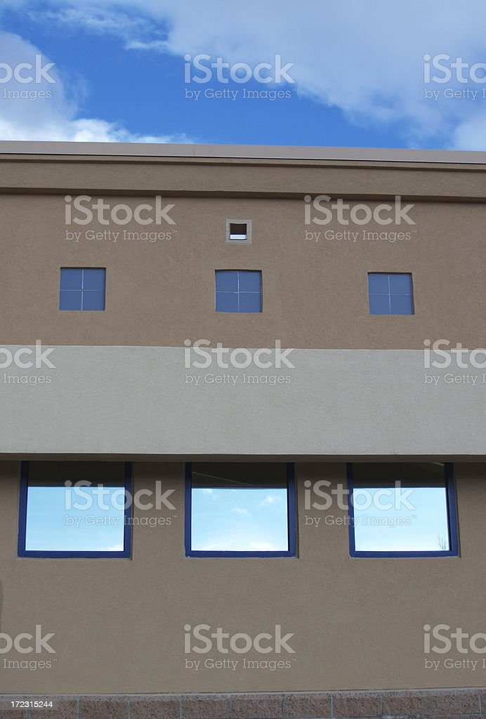Office Building Blue Sky Windows stock photo