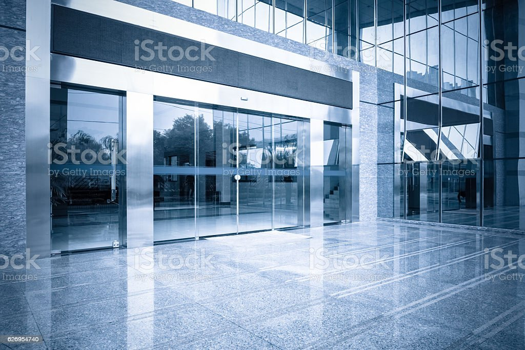 office building entrance and automatic glass door stock photo