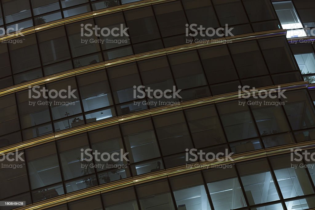 Office building facade at night in Brussels, Belgium royalty-free stock photo