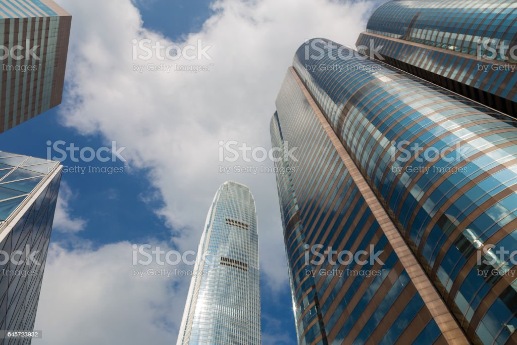 Office building from bottom view against blue sky stock photo