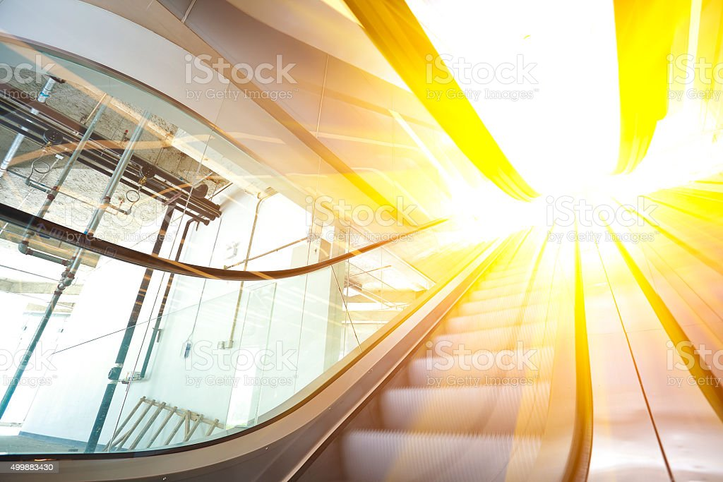 office building  interior escalators and stairs stock photo