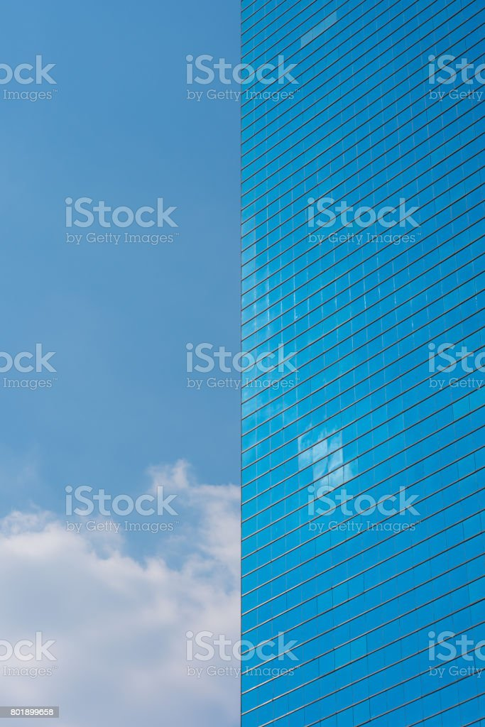 Office building vertical background. Skyscraper and blue sky stock photo
