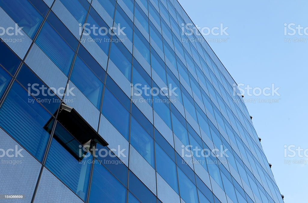 Office building with an open window royalty-free stock photo