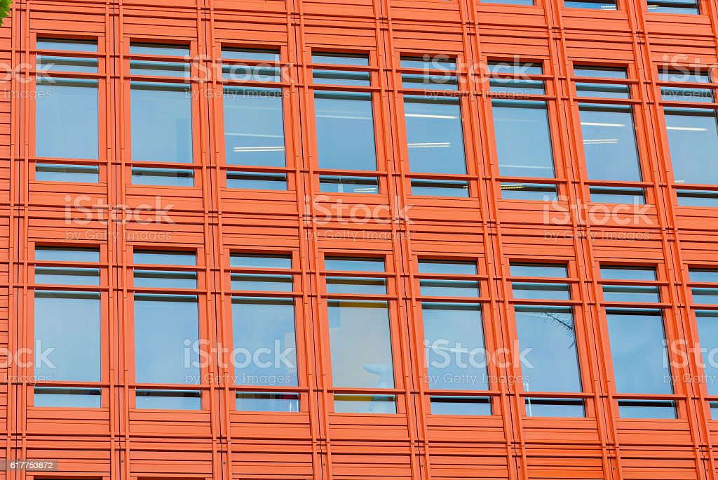 Office building with bright orange front. stock photo